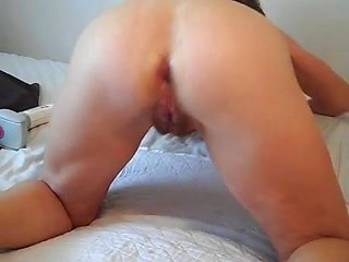 Mature asshole loosened with thick pink dildo...