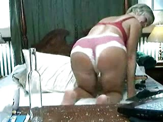 Sexy mature with short hair plays with her...