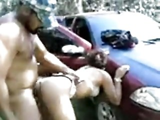Husband fucks his wife outdoors in...